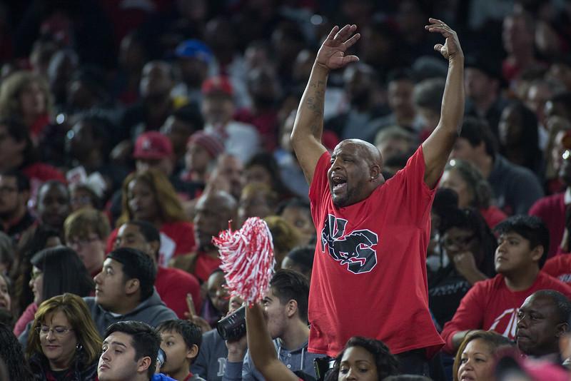 Lifelong North Shore fan Michael Johnson cheers on his team