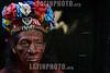 Nicaragua - Managua 01/Agosto/2014 Guillermo Zapata , ( El Diablo Rojo ) junto a su ex companera y madre de su hijo Maria Mercedes Salazar ( La Cacique ) se preparan con su vestimenta , adornos y pinturas que se aplican en sus cuerpos para pagar su promesa a la diminuta imagen de Santo Domingo de Guzman . Zapata y Salazar se pintan de forma mutua y aunque ya no esten juntos sentimentalmente ambos dicen que ahora son como hermanos / Nikaragua : Die Figur des roten Teufels - l Diablo Rojo - Feiertag Santo Domingo de Guzman © Oscar Navarrete/LATINPHOTO.org