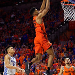 University of Florida Gators guard Jalen Hudson gets an ally oop pass from University of Florida Gators guard Chris Chiozza and slams it in during the second half as the Gators take on the Kentucky Wildcats in Exactech Arena at the Stephen C. O'Connell Center in Gainesville, Florida.  March 3rd, 2018. Gator Country photo by David Bowie.