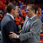 University of Florida Gators mens basketball head coach Mike White meets with Kentucky head coach John Calipari during pregame as the Gators host the Kentucky Wildcats in Exactech Arena at the Stephen C. O'Connell Center in Gainesville, Florida.  March 3rd, 2018. Gator Country photo by David Bowie.