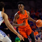University of Florida Gators guard Mike Okauru dribbles up court during the first half as the Gators host the Kentucky Wildcats in Exactech Arena at the Stephen C. O'Connell Center in Gainesville, Florida.  March 3rd, 2018. Gator Country photo by David Bowie.