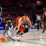 University of Florida Gators guard Egor Koulechov dives for a loose ball during the first half as the Gators host the Kentucky Wildcats in Exactech Arena at the Stephen C. O'Connell Center in Gainesville, Florida.  March 3rd, 2018. Gator Country photo by David Bowie.