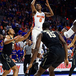 University of Florida Gators guard Mike Okauru during the first half as the Gators lead 40-20 over the Vanderbilt Commodres in Exactech Arena at the Stephen C. O'Connell Center in Gainesville, Florida.  December 30th, 2017. Gator Country photo by David Bowie.