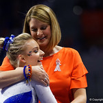 University of Florida Gators gymnist Alyssa Baumann gets a hug from University of Florida Gators gymnastics head coach Jenny Rowland as the Gators host the University of Georgia Bulldogs in Exactech Arena at the Stephen C. O'Connell Center in Gainesville, Florida.  February 9th, 2018. Gator Country photo by David Bowie.