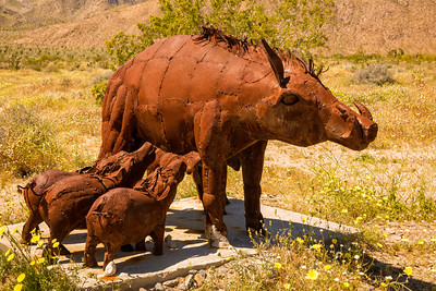 Mother and babies warthog metal sculptures at Anza-Borrego State Park in California