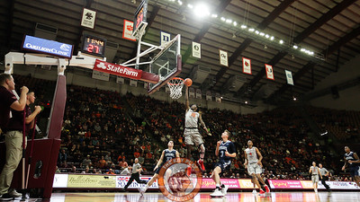Chris Clarke goes up for a layup in the first half.  (Mark Umansky/TheKeyPlay.com)