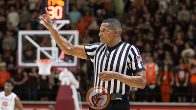 Referee Teddy Valentine signals for a free throw in the second half. (Mark Umansky/TheKeyPlay.com)