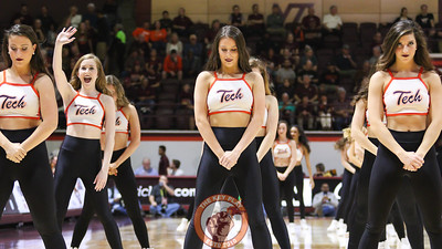 A member of the Virginia Tech High Techs waves to the crowd before starting a routine during a media timeout. (Mark Umansky/TheKeyPlay.com)
