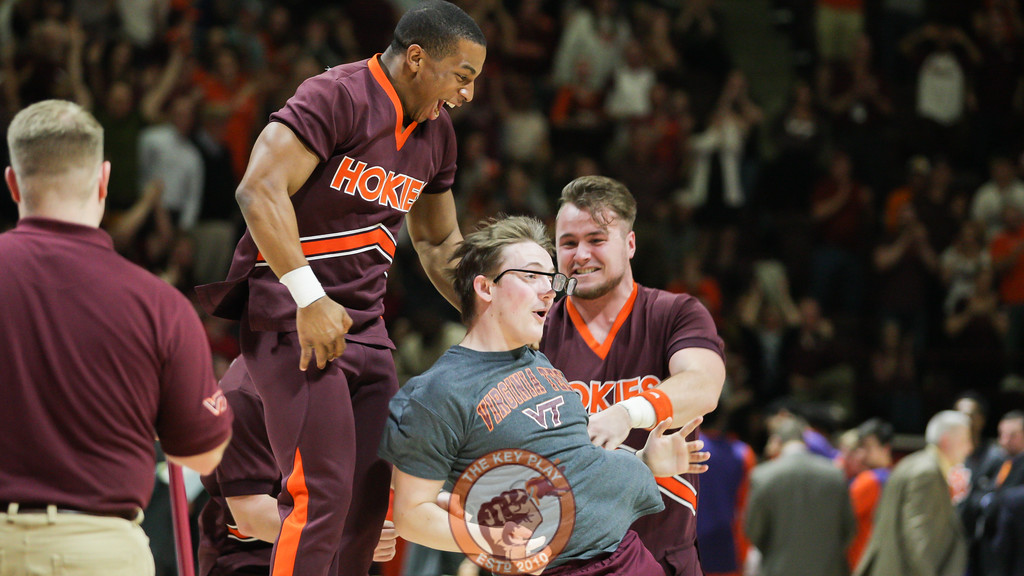 A student celebrates with the cheerleaders after making a half-court shot for $10,000. (Mark Umansky/TheKeyPlay.com)