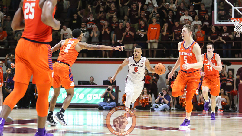Justin Robinson dribbles the ball out of the Virginia Tech end in the second half. (Mark Umansky/TheKeyPlay.com)
