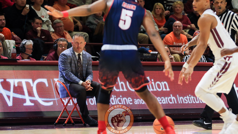 Head coach Buzz Williams sits on a stool on the sideline as he watches the game. (Mark Umansky/TheKeyPlay.com)