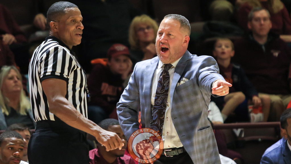Head coach Buzz Williams argues with referee Teddy Valentine over a charge foul. (Mark Umansky/TheKeyPlay.com)