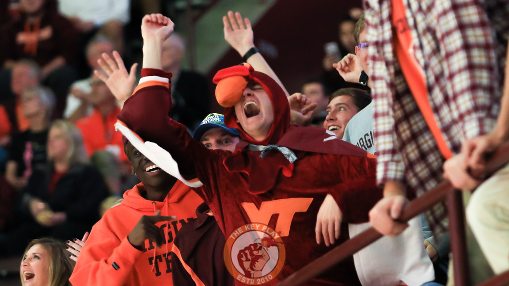 A fan dressed as a Hokiebird yells in the front row of the student section. (Mark Umansky/TheKeyPlay.com)