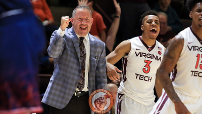 Head coach Buzz Williams and Wabissa Bede celebrate a Virginai Tech basket. (Mark Umansky/TheKeyPlay.com)