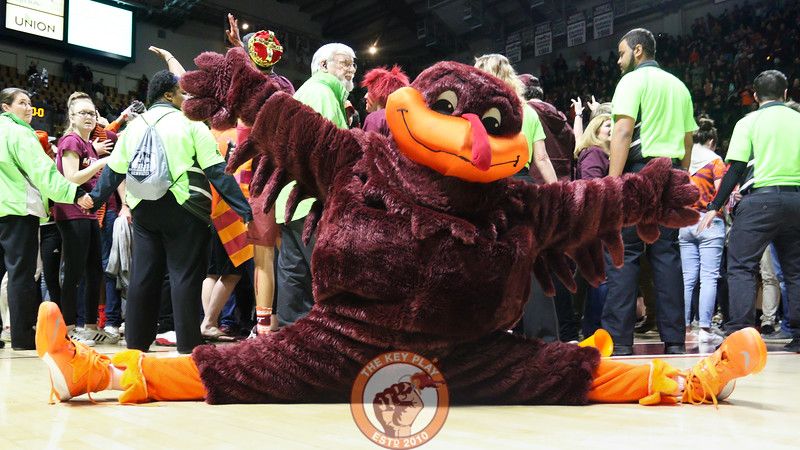 The Hokiebird shows off some athletic skills as students storm the court following the win. (Mark Umansky/TheKeyPlay.com)