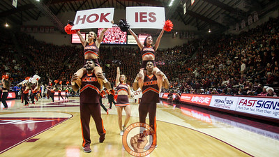 "The Virginia Tech cheerleaders lead the crowd in a ""Lets Go Hokies"" cheer during a media timeout. (Mark Umansky/TheKeyPlay.com)"