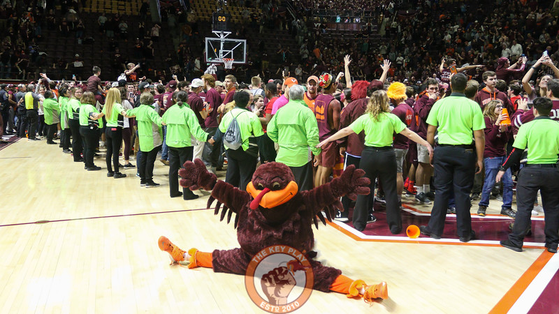 The Hokiebird shows off some athletic skills as students storm the court following the win. Virginia Tech defeated #3 Duke, 64-63. (Mark Umansky/TheKeyPlay.com)