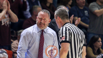 Hokies head coach Buzz Williams speaks with a referee in the second half. (Mark Umansky/TheKeyPlay.com)