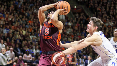 Justin Robinson is fouled from behind on a drive towards the basket late in the second half. (Mark Umansky/TheKeyPlay.com)