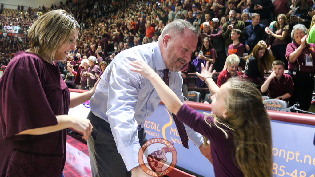 Head coach Buzz Williams greets his family on the edge of the court after the game ends. (Mark Umansky/TheKeyPlay.com)