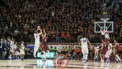 Duke's Grayson Allen attempts a desperation three point shot to try and steal the win back as Justin Robinson gets a hand in his way. The shot fell short as time expired. (Mark Umansky/TheKeyPlay.com)