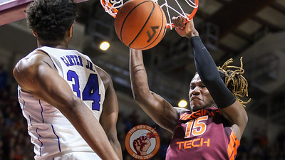 Chris Clarke dunks the ball over Duke's Wendell Carter Jr. as the Hokies try to complete the comeback. (Mark Umansky/TheKeyPlay.com)