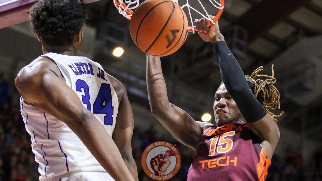 Chris Clarke dunks the ball over Duke's Wendell Carter Jr. as the Hokies try to complete the comeback. (Mark Umansky/TheKeyPlay.com)