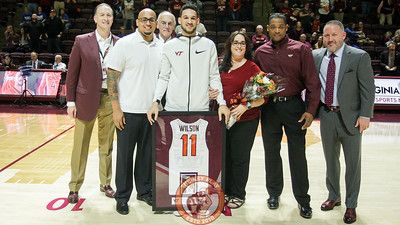Devin Wilson poses with his family, head coach Buzz Williams, and VT athletic director Whit Babcock as he is honored before the game for senior day. (Mark Umansky/TheKeyPlay.com)