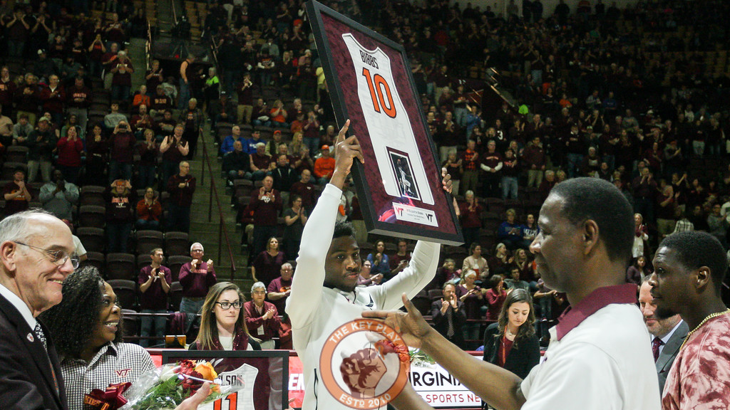 Justin Bibbs holds up a framed jersey as a part of senior day ceremonies before the game. (Mark Umansky/TheKeyPlay.com)