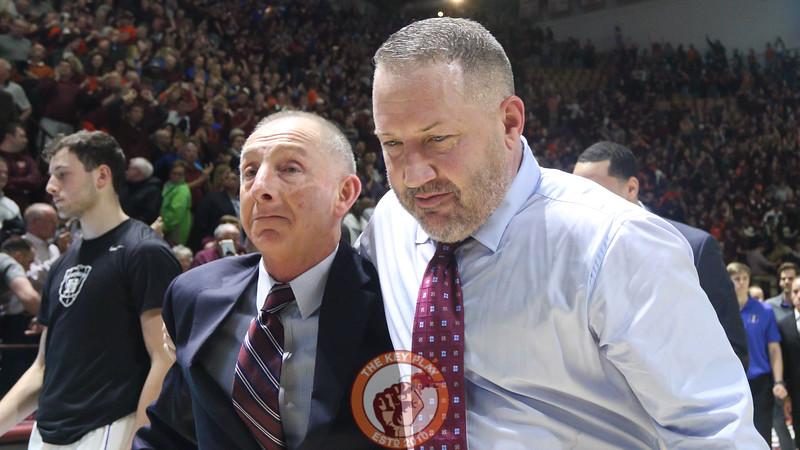 Head coach Buzz Williams hugs assistant coach Jeff Reynolds as they walk off the court. (Mark Umansky/TheKeyPlay.com)