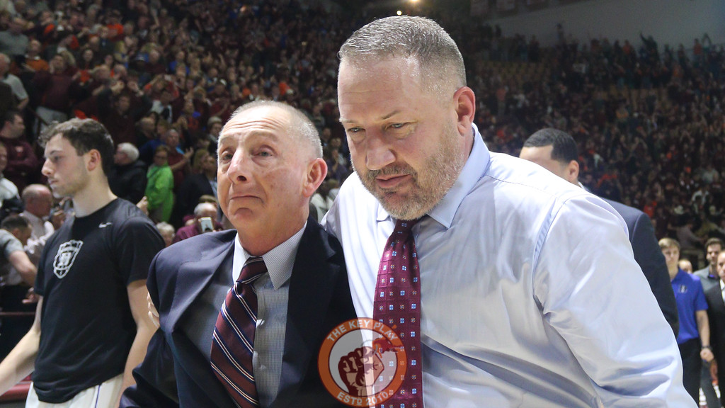 Head coach Buzz Williams hugs assistant coach Jeff Reynolds as they walk off the court. (Mark Umansky/TheKeyPlay.com)