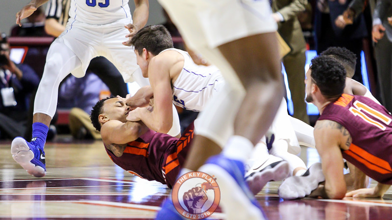 Justin Robinson and Duke's Grayson Allen fight for a loose ball early in the first half. (Mark Umansky/TheKeyPlay.com)