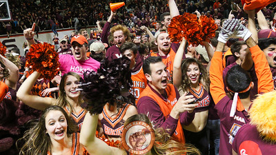 Virginia Tech cheerleaders and High Techs celebrate as students start to storm the court from the stands. (Mark Umansky/TheKeyPlay.com)