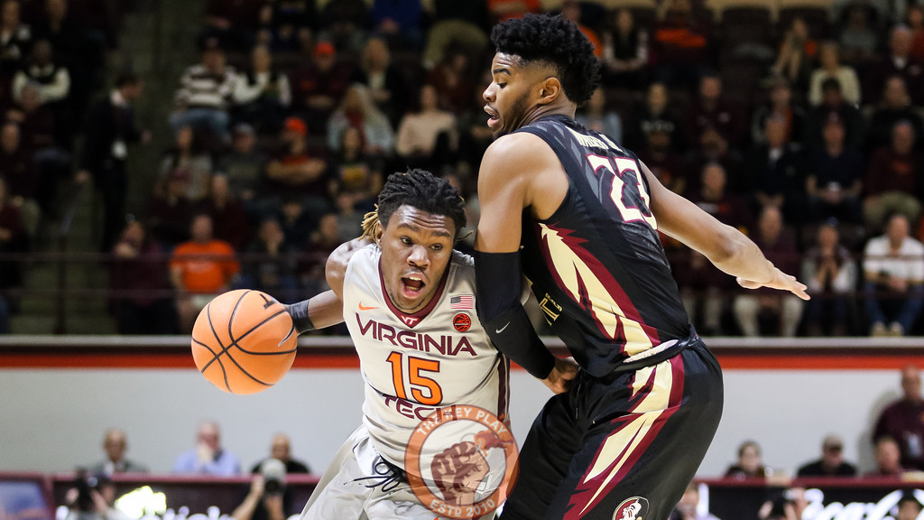 Chris Clarke attempts to dribble the ball through the Florida State defense in the first half. (Mark Umansky/TheKeyPlay.com)