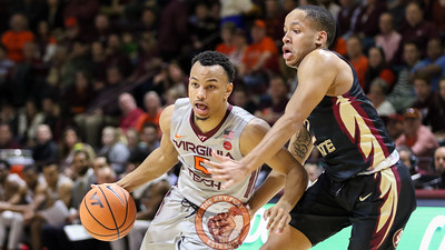 Justin Robinson is heavily defensed as he dribbles the ball. (Mark Umansky/TheKeyPlay.com)