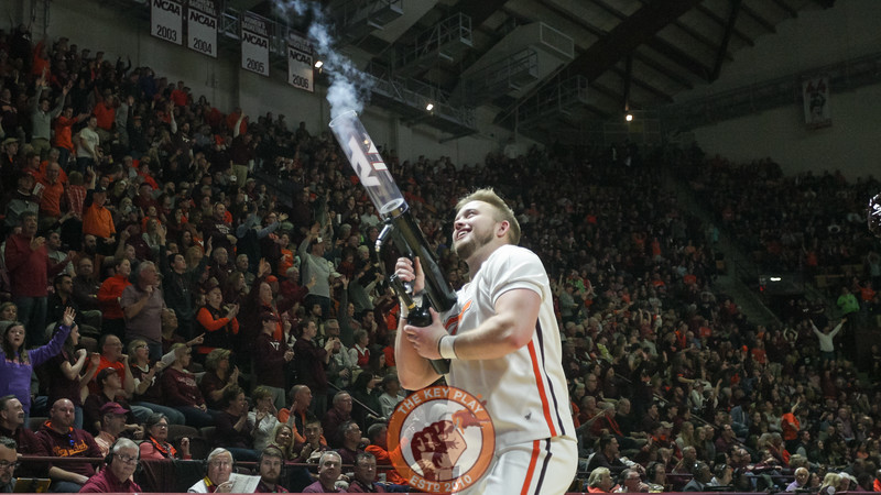 The Virginia Tech cheerleaders fire off t-shirts into the crowd during a media timeout. (Mark Umansky/TheKeyPlay.com)
