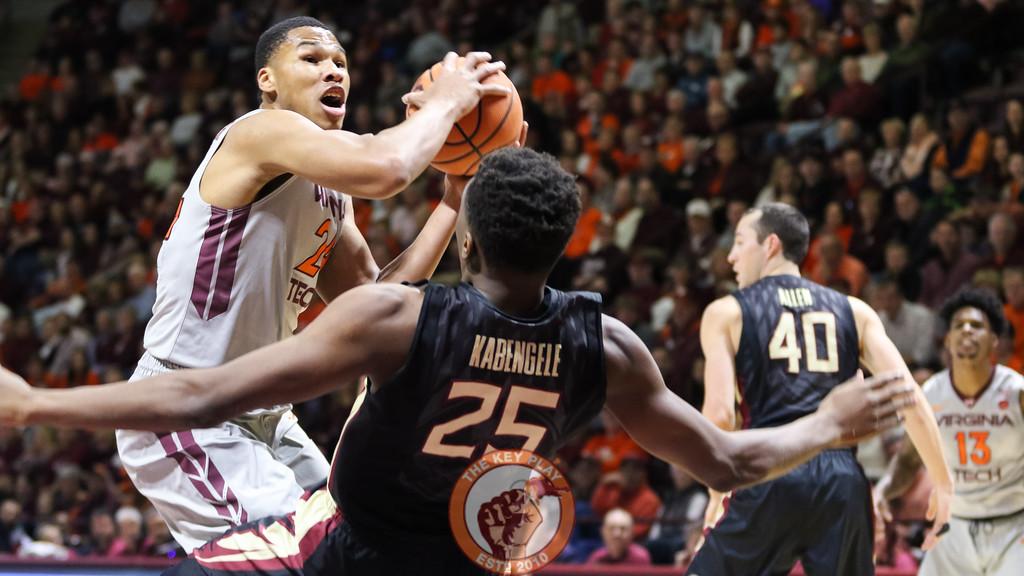 Kerry Blackshear Jr. draws a foul on a layup underneath the basket. (Mark Umansky/TheKeyPlay.com)