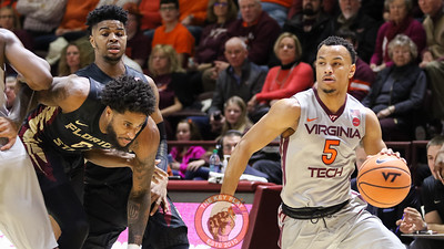 Justin Robinson dribbles around the FSU defense in the first half. (Mark Umansky/TheKeyPlay.com)