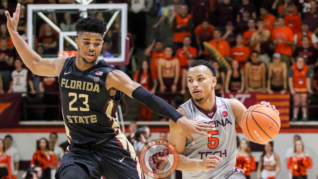 Justin Robinson attempts to dribble the ball to the basket late in the second half. (Mark Umansky/TheKeyPlay.com)