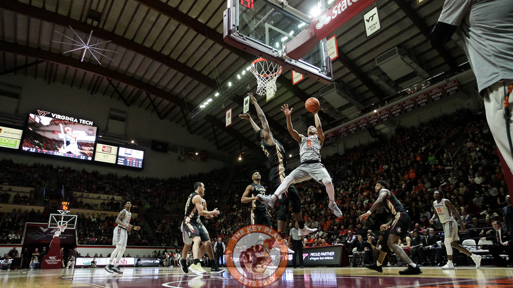 Justin Robinson leaps through the air on a layup attempt in the first half. (Mark Umansky/TheKeyPlay.com)