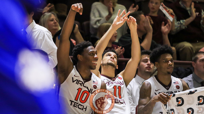 Justin Bibbs and Devin Wilson celebrate a Hokies' three point shot in the second half. (Mark Umansky/TheKeyPlay.com)