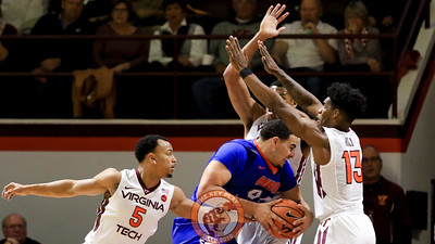 Justin Robinson and Ahmed Hill closely guard a drive towards the Virginia Tech basket in the first half. (Mark Umansky/TheKeyPlay.com)