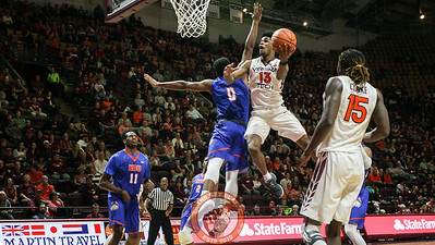 Ahmed Hill flies through the air on a heavily defended layup attempt. (Mark Umansky/TheKeyPlay.com)
