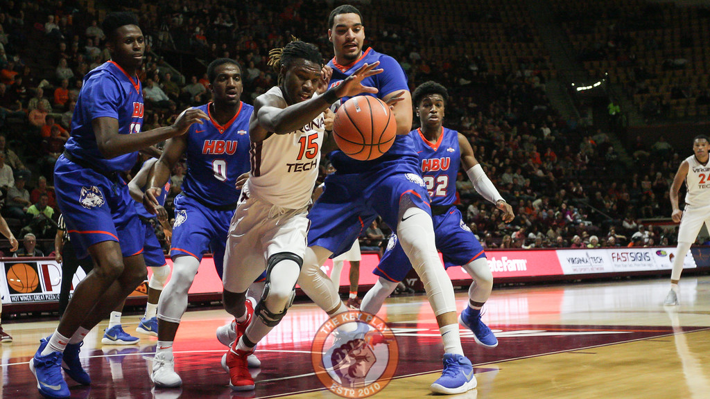 Chris Clarke chases down a loose ball underneath the HBU basket in the first half. (Mark Umansky/TheKeyPlay.com)