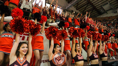 The Virginia Tech spirit squads and students hold up their arms right before a Hokies free throw attempt. (Mark Umansky/TheKeyPlay.com)