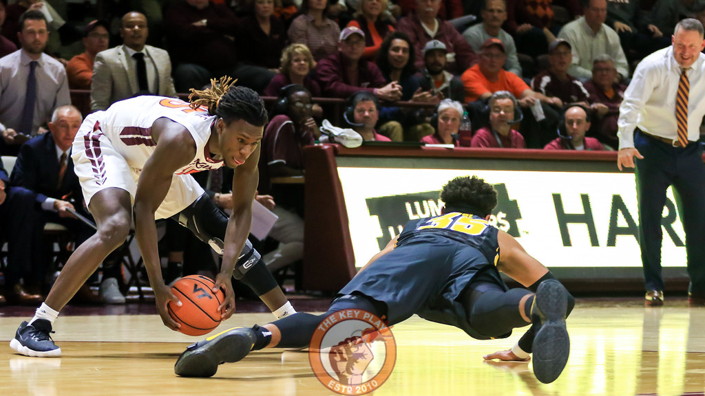 Chris Clarke picks up a loose ball in front of the Virginia Tech bench in the second half. (Mark Umansky/TheKeyPlay.com)