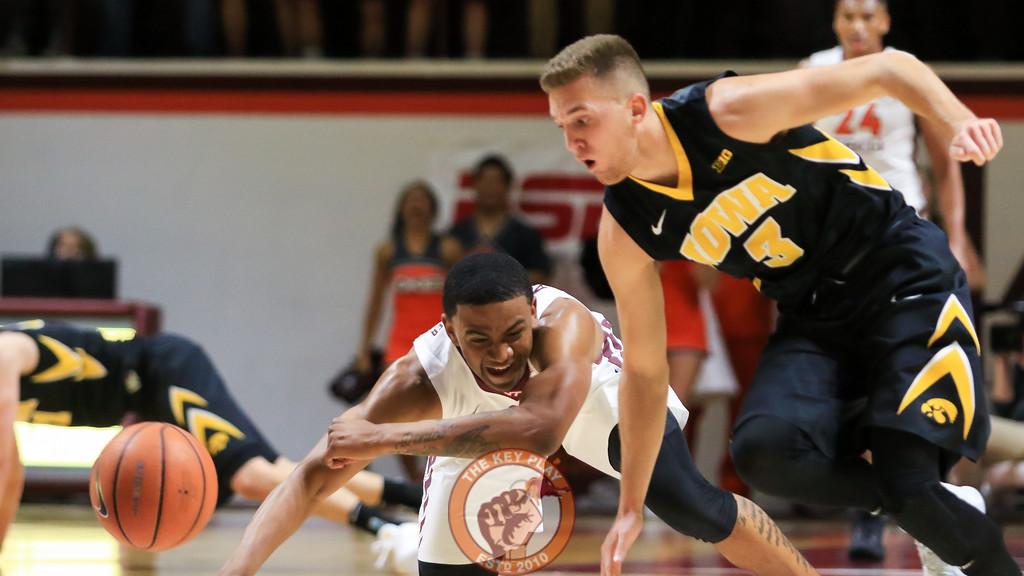 Nickeil Alexander-Walker fights for a loose ball against Iowa's Jordan Bohannon. (Mark Umansky/TheKeyPlay.com)