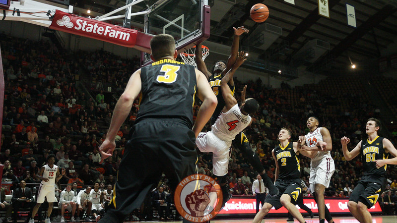 Nickeil Alexander-Walker is blocked by Iowa's Tyler Cook on a layup attempt. (Mark Umansky/TheKeyPlay.com)
