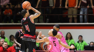 Louisville's Quentin Snider rises up for a late three point attempt to put the game away. The Hokies lost to Louisville 75-68. (Mark Umansky/TheKeyPlay.com)