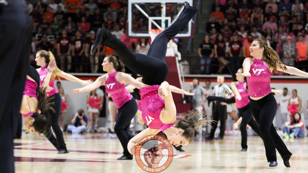 A member of the High Techs performs a flip during a media timeout routine. (Mark Umansky/TheKeyPlay.com)